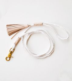 A pretty blush leather and white rope dog leash.