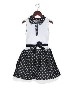 A Peter Pan collar adds timeless charm to this darling drop-waist dress, featuring a playful polka dot pattern and a drop-waist design.
