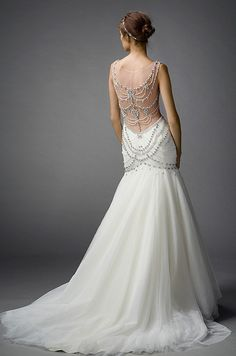 The back of this Watters wedding dress is dripping in bling. Click to view the whole fabulous collection.