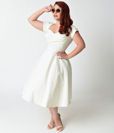 If youre simply enamored by all things 1950s (or Mad Men), youll adore this ivory cap sleeved plus size swing dress from our friends at Stop…