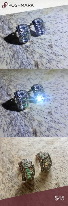 "Carolee Emerald Cut Glass Clip On Earrings These are gorgeous! They are very comfortable clip ons. Silver plated with three center emerald cut crystals surrounded by a rectangular bezel of little crystals. These earrings are 3/4"" long. Carolee Jewelry Earrings"