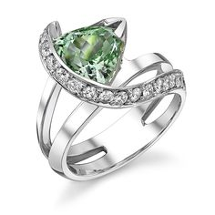 Brides.com: Green Engagement Rings. Style 1536000006, 14k white gold Vision ring with 2.34ct green tourmaline trillion accented with 0.52ctw of white diamonds, $7,316, Mark Schneider Design  See more round-cut engagement rings.