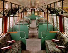 Underground book: interior of 1938 tube stock carriage.  The comfortable interior of a 1938 stock car. The cars, which entered service in 1937/8, were a great improvement on what came before, boasting deep-cushioned seats covered in woollen moquette , slatted hardwood floors and art deco lampshades. They were hardwearing, too, and still in good condition when this photograph was taken in the 1960s