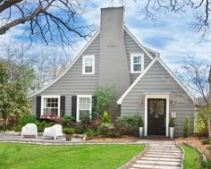 Accenting This Grey House With Black Dark Shutters Is A