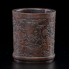 Chinese, 19th century.  A rosewood brushpot, relief carved in full surround with thousand antiques; ht. of brush pot 6 in.