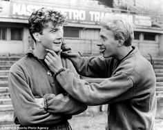 Joe Baker (left) and Denis Law back in training following a car crash in Italy