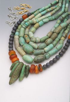 Four inner strands and the beads at the center of the outer strand are African amazonite stone beads from Mauritania.| ©Robert K. Liu