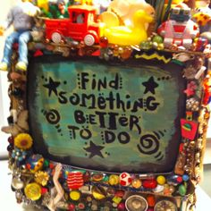 This is an old television painted with the words find something better to do and all kinda of toys and things kids used to do before tv!