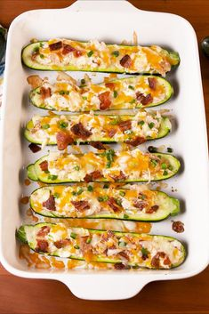 Jalapeño Popper Zucchini Boats- - Jalapeño poppers are our favorite appetizers so naturally we turned them into an actual dinner. We skipped the frying and put them into zucchini boats for a low-carb, easy take on the favorite we can't get enough of. Jalapeno Poppers, Sin Gluten, Zucchini Boat Recipes, Stuffed Zucchini Recipes, Vegetarian Zucchini Boats, Zucchini Bars, Cooking Zucchini, Recipe Zucchini, Zucchini Squash