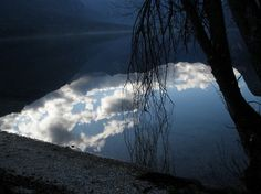 Mirroring the Sky - the sky appears upside-down in Lake Bohinj, Slovenia  #photography
