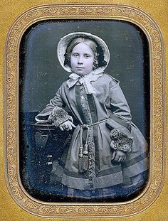 Little girl in winter wear, c. mid-19th C. Notice the separate fur cuffs.