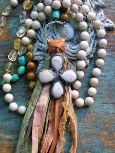 Lush leather or silk tassels hung on long hand-knotted necklaces! Decorated with vintage finds or one of my soldered embellishments, these fab,