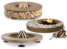 Modern fire pit - we're putting ours into the ground with river rock surround with stained jarrah timber.