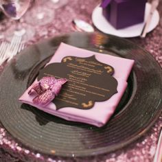 Pink napkins were topped with laser-cut, silk-screened menu cards that mimicked the invitation design.