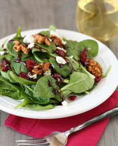 A simple spinach salad topped with goat cheese and craisins and tossed in a homemade balsamic vinaigrette.