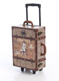 Design leopard print suitcase $169.00 - a necessity for traveling to paradise.