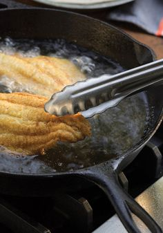When it comes to fried catfish (one of the most underestimated seafood dishes we've ever had), it's all about the cornmeal; coating the fillets with the pebbly textured grain results in pieces that are crunchy and light and not at all greasy.