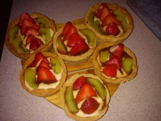 Pastry baskets filled with custard and fresh fruits