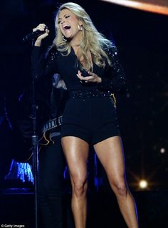 It's our turn: Carrie Underwood may have been hosting but she still found time during the show to perform
