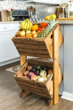 Love heading to the farmer's market? Looking for a fun way to showcase your fruits and vegetables, while saving counter space? Try building this DIY two-tier produce stand to give all your fruits and vegetables a functional, stylish home right in your kit #rustichomedecor