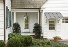 Gray metal awning over door (modern farmhouse). Metal Awning, Metal Roof, Copper Awning, White Exterior Houses, Exterior Doors, Back Doors, Entry Doors, Garage Door Design, Garage Doors