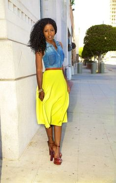 Shop this look on Lookastic: https://lookastic.com/women/looks/blue-vest-yellow-midi-skirt-burgundy-heeled-sandals-gold-watch/11995 — Blue Denim Vest — Gold Watch — Burgundy Leather Heeled Sandals — Yellow Midi Skirt