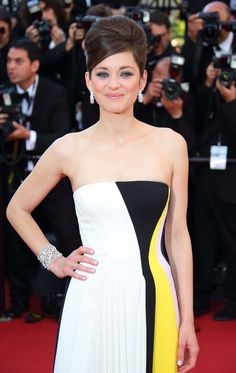 Marion Cotillard wore Chopard's Green Carpet Collection jewels for their first outing on the red carpet at the Cannes Film Festival 2013.