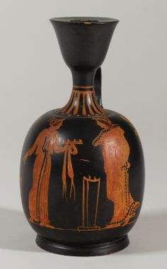 A PAESTAN RED-FIGURED SQUAT LEKYTHOS, ATTRIBUTED TO THE WORKSHOP OF ASTEAS, CIRCA 350-330 B.C.
