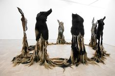 """Nandipha Mntambo ~ """"Silence and Dreams"""" (2008) Cowhide, cows' tails, resin, polyester mesh, waxed cord. Installation of 8 figures. via Andréhn-Schiptjenko *good source for her works*"""