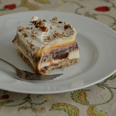 'Jane's Delight' recipe from Carol (tall tales from Kansas blog). nut crust, cool whip, cream cheese, chocolate and vanilla pudding- what more do you need? Nothing!