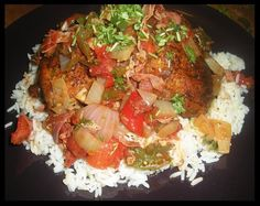 Roasted chicken with tomato, paprikas, prosciutto, white wine sauce, herbed long grain rice, topped with parsley