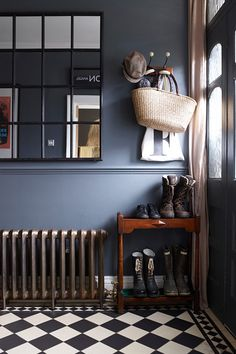 Dark hallway interiors with inky blue walls, a cast iron radiator and window pane wall mirror. Compact shoe storage for hallway. Also, I'd forgotten how much I LOVE chequered floors. Home Design, Flur Design, Interior Design, 1930s House Interior, Modern Interior, Tiled Hallway, Dark Hallway, Hall Tiles, Entry Tile