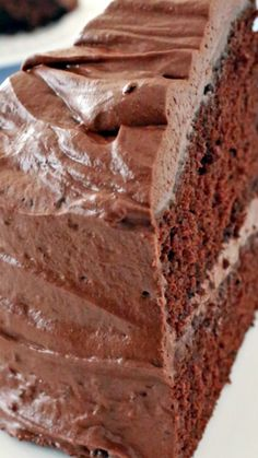 My Favorite Chocolate Cake ~ It's a tried and true favorite that always bakes up tall, moist, fluffy and delectable... The chocolate frosting is extra light and super creamy, almost silky