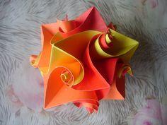Origami cuboctahedron: curlicues and modular origami