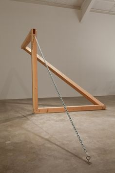Oscar Tuazon | Untitled - 2012 / douglas fir, chain, steel. 8x18x8 feet.