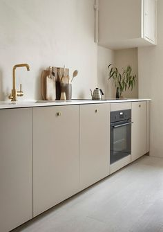 Kitchen with beige cabinets and brass details