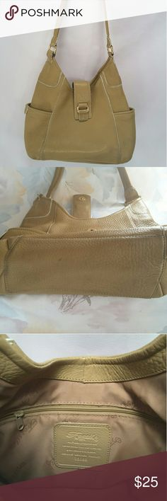 "Fossil brown leather hobo purse Fossil 75082 caramel brown hobo purse.   Features include exterior slip pockets, inner wall zipper pocket and two multifunction slip pockets.   Condition; bottom corners are slightly worn and shoulder strap has a tiny scratch, other than that is in good condition, lining is slightly dirty. See pics.   Length 13"" Height 8"" Width 4"" Strap drop 15""  Pets and smoking free home. Fossil Bags Hobos"
