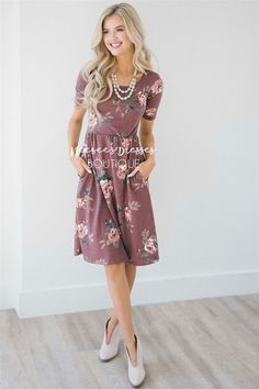 Adorable fit and beautiful color! You are going to love the Natalie! Gorgeous dusty burgundy dress features a pretty floral print, half sleeves, a round neckline and elastic waist.