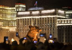 People take pictures of the burning symbol of spring, which looks like a brown bear emerging from his den. The bear was created by Hungarian artist Gabor Miklós Szoke for the festival in Gorky Park during a celebration of Maslenitsa, or Shrovetide in Moscow, Russia, on March 13, 2016, with the building of the National Defense Center of Russian Defense Ministry in the background.