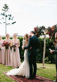 LOVE: Flowers, Arch, Rug and Bridesmaid dresses