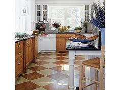 This pleasant kitchen has painted floors in a checkerboard pattern to add some interest under your feet. Playful flooring is an unexpected way to have some fun with your design scheme. - Home and Garden Design Idea's