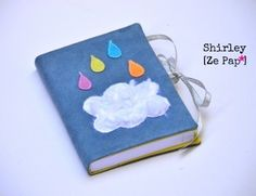 Agenda 2013-2014 une page par jour en suédine ciel orageux, nuage fourrure et gouttes multicolores !