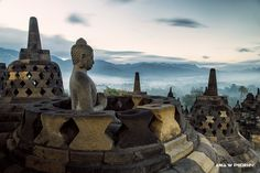 Buddha statue in Borobudur Temple in Indonesia, UNESCO World Heritage. ANIA W PODRÓŻY travel blog and photography