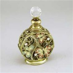 Scrolled die-cast metal butterfly perfume bottle with crystal and jewel accents to hold your classic perfume that defines only you.