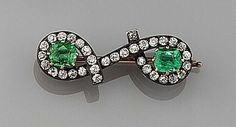 AN EMERALD AND DIAMOND BROOCH BY FABERGÉ, WORKMASTER KNUT OSKAR PIHL, MOSCOW, LATE 19TH CENTURY. Designed as a twisted rope, pavé-set with circular-cut diamonds and two claw-set cushion-shaped emeralds.