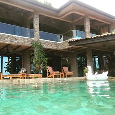Beautiful infinity pool with a gorgeous deck and balcony at Casa De Los Suenos. The deck has very comfy loungers perfect for tanning. Located in Hermosa Heights, Guanacaste Costa Rica. #swanfloat #swan