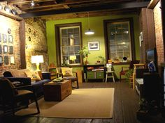 I love this warm brick loft with the bright green accent wall. Its probably in boston, NY only looks like that in movies.