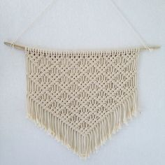 Macrame wall hanging for your boho decoration.  Made of cotton and wood  Measurements : 70 cm X 50 cm