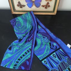 Emilio Pucci scarf Beautiful silk and wool blend 100% authentic Pucci scarf. Blue, purple, black and seafoam green blend! Made in Italy. Perfect condition. Purchased at Bergdorf Goodman in 2009. Emilio Pucci Accessories Scarves & Wraps