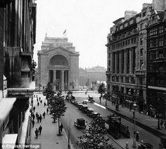 Bush House, Aldwych, London, circa 1932. And here is how it looks now: http://i.dailymail.co.uk/i/pix/2010/03/18/article-1258785-086ADD13000005DC-927_470x423.jpg